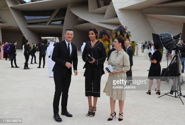 Welsh actor Luke Evans and US actress Ella Balinska attend the official opening ceremony for the National Museum of Qatar in the capital Doha on...