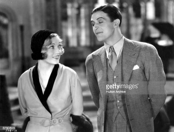 Welsh actor Ray Milland chats with actress Marion Davies in a scene from 'Bachelor Father'. Title: Bachelor Father Studio: MGM Director: Robert Z...