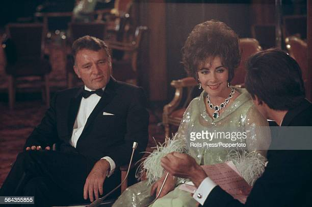 Welsh actor Richard Burton and his wife American actress Elizabeth Taylor being interviewed prior to a Bafta Awards dinner in London on 26th April...