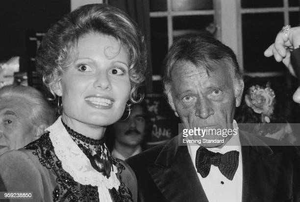 Welsh actor Richard Burton attending a party with his wife British fashion model dancer and choreographer Suzy Miller UK 5th July 19978