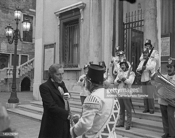 Welsh actor Richard Burton shaking the hand of the music band chief on the Wagner movie set Venice 1983