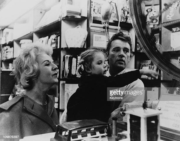 Welsh actor Richard Burton visits a toy shop in Rome with his wife Sybil and their daughter Jessica 1961 Burton is in the Italian capital for the...