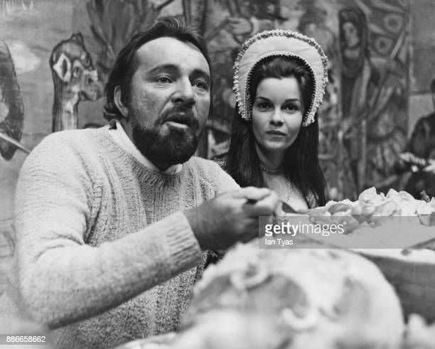 Welsh actor Richard Burton with Canadian actress Geneviève Bujold during a reception for the stars of the film 'Anne of the Thousand Days' at...