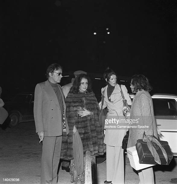 Welsh actor Richard Burton with Liz Taylor portrayed while standing in a car parking Lido Venice 1974