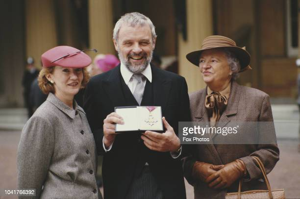 Welsh actor Sir Anthony Hopkins receives a CBE at Buckingham Palace in London 3rd November 1987 He is accompanied by his wife Jennifer and mother...