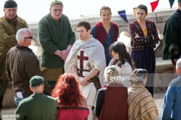 Welsh actor Taron Egerton as 'Robin Hood' and Irish actress Eve Hewson as 'Maid Marian' play during the film shooting of 'Robin Hood Origins' in...