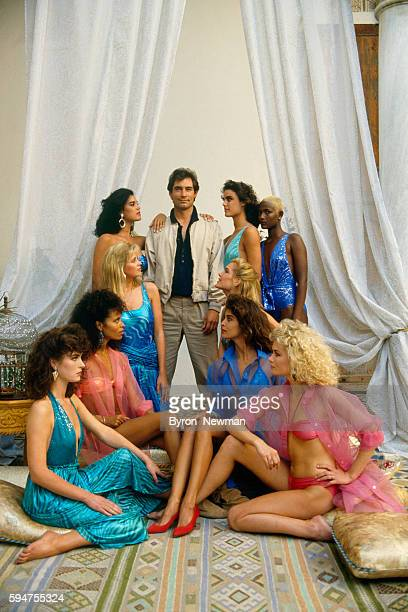 Welsh Actor Timothy Dalton surrounded by all his James Bond Girls on the set of The Living Daylights by British director John Glen Sharon Devlin Femi...