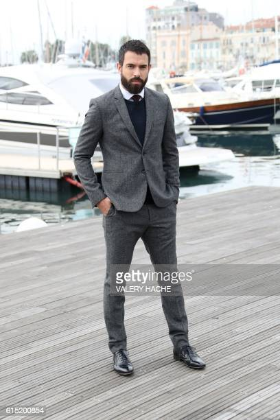 Welsh actor Tom Cullen poses for a photocall for the TV series 'Knightfall' as part of the MIPCOM on October 17 2016 in Cannes southeastern France /...