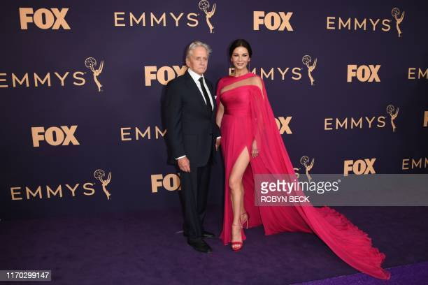 TOPSHOT Welsh actress Catherine ZetaJones and husband US actor Michael Douglas arrive for the 71st Emmy Awards at the Microsoft Theatre in Los...