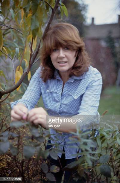 Welsh actress Nerys Hughes in the garden of her home in Putney London 12th January 1982