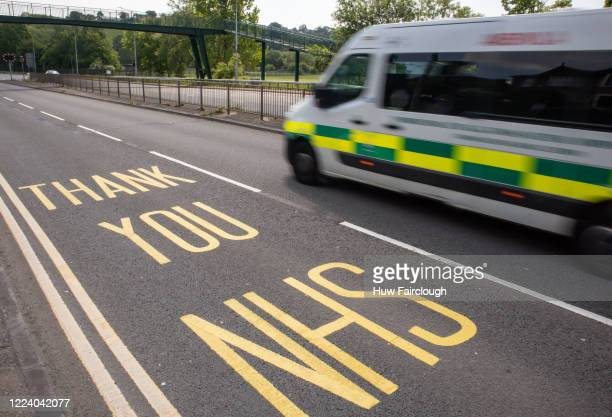 Welsh Ambulance heads towards The Royal Gwent Hospital Newport travelling passed a bilingual Thank You NHS road marking on May 09 2020 in Newport...