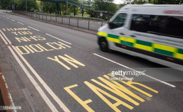 Welsh Ambulance is heading towards The Royal Gwent Hospital Newport travelling passed a bilingual Thank You NHS road marking on May 9 2020 in Newport...