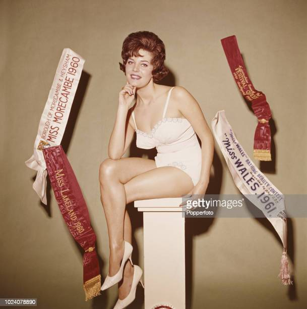 Welsh born beauty queen Rosemarie Frankland pictured with her winning sashes after winning the Miss World 1961 beauty pageant to be crowned Miss...