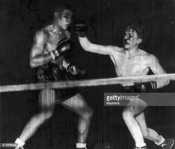 Welsh boxer Tommy Farr lands a blow to Joe Louis' face in the 14th round of a World Heavyweight Championship fight in New York 31st August 1937 Louis...