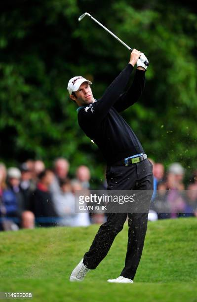 Welsh Bradley Dredge watches his drive to the 2nd green during the final round of the PGA Championship at Wentworth Golf Club in Surrey England on...