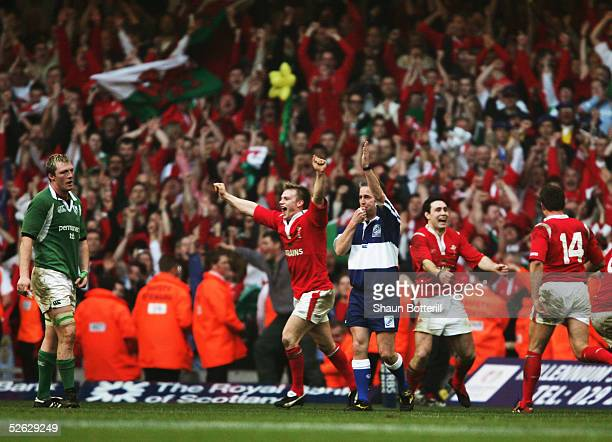Welsh celebrations begin as Referee Chris White blows the final whistle during the RBS Six Nations match between Wales and Ireland at the Millenium...