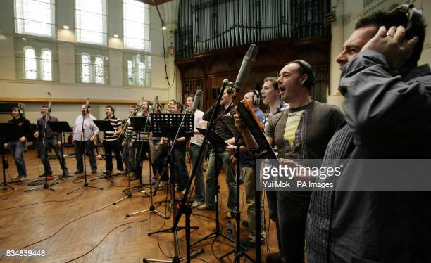 Welsh choir 'Only Men Aloud' winners of BBC1's 'Last Choir Standing' competition with music director and conductor Tim RhysEvans during a recording...