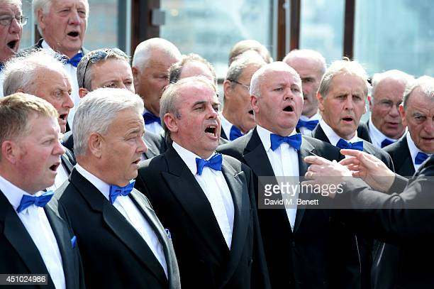 Welsh Choir performs 'West End Girls' by the Pet Shop Boys at Shoreditch house to promote Festival No 6 at Portmeirion on June 21 2014 in London...