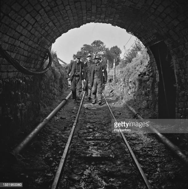 Welsh coal miner Even Rhoderick Jones and his workmates Mr Jenkins and Mr Davis walk down the drift to the coal mine entrance to start a shift at...
