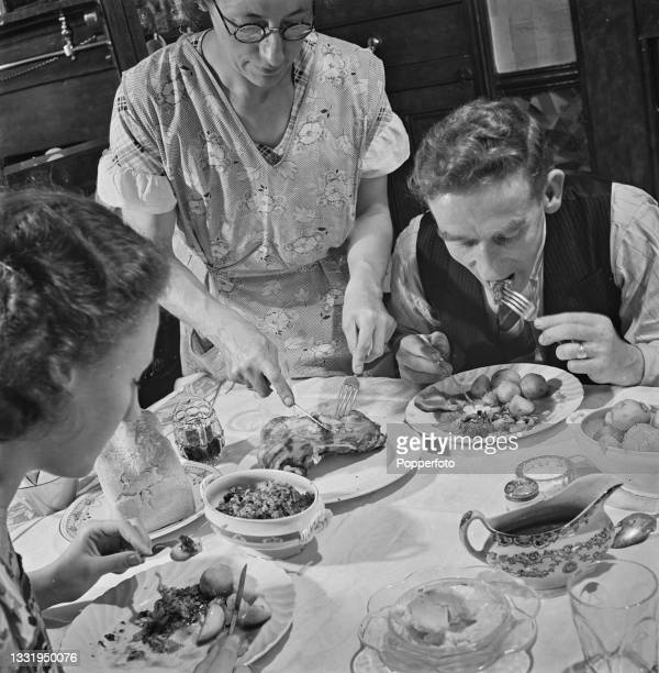Welsh coal miner Even Rhoderick Jones eats a Sunday roast dinner with his wife and daughter in the dining room of their house in the village of...