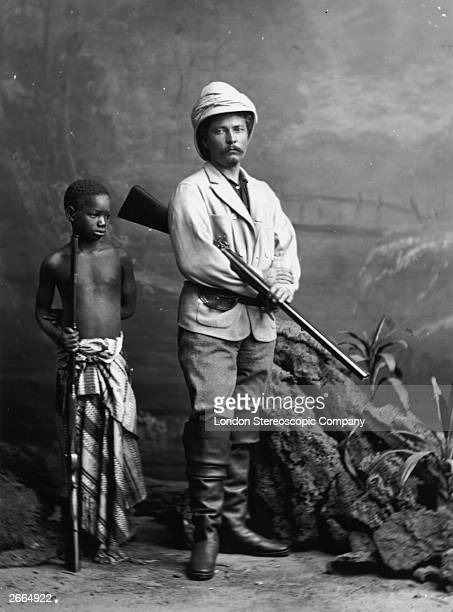 Welsh explorer and journalist Sir Henry Morton Stanley with his boy Kalula posing in the clothes he wore when he met fellow explorer Dr David...