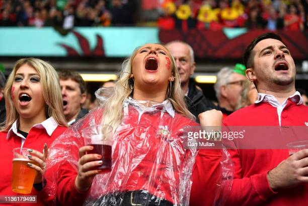 Welsh fan sings the national anthem prior to the Guinness Six Nations match between Wales and Ireland at Principality Stadium on March 16 2019 in...