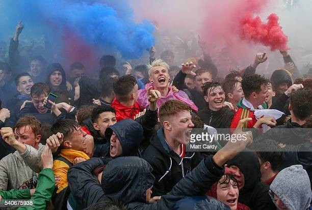 Welsh fans celebrate after Gareth Bale scored the first goal during the UEFA EURO 2016 Group B match between England and Wales on June 16 2016 in...