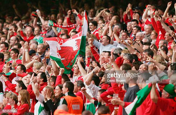 Welsh fans celebrate as Wales win the Grand Slam after defeating Ireland in the RBS Six Nations International between Wales and Ireland at The...