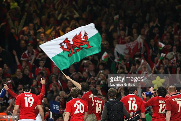 Welsh fans celebrate with the fans following their Grand Slam victory during the RBS Six Nations Championship match between Wales and France at the...