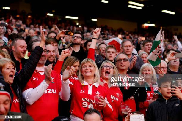 Welsh fans cheer during the Six Nations international rugby union match between Wales and England at the Principality Stadium in Cardiff south Wales...
