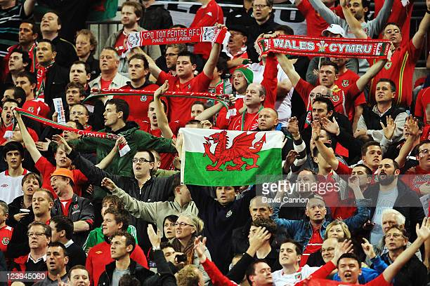 Welsh fans support their team during the UEFA EURO 2012 group G qualifying match between England and Wales at Wembley Stadium on September 6 2011 in...