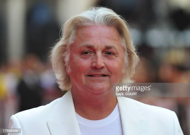 Welsh fashion designer David Emanuel attends the world premiere of Diana in central London on September 5 2013 The film is a biopic of the late...