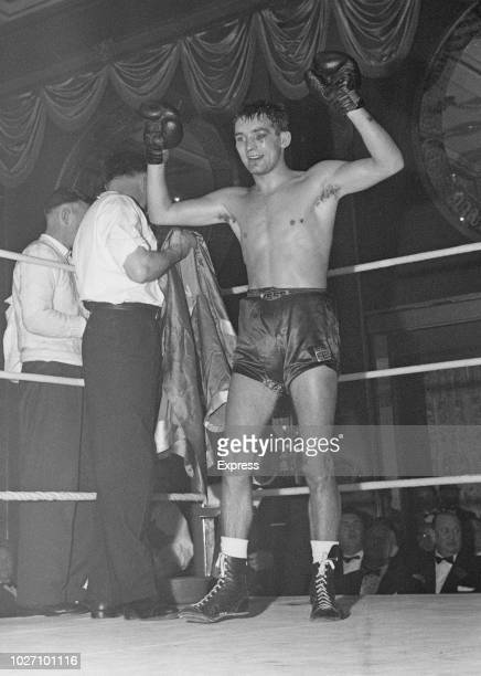 Welsh featherweight boxer Howard Winstone raises his arms in the air in celebration after beating John O'Brien on points to retain his European...