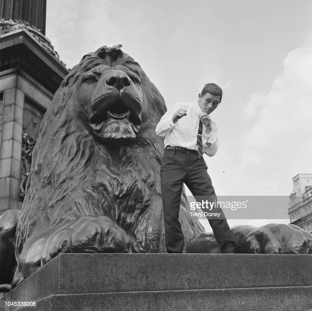 Welsh featherweight boxer Lennie Williams aka Lennie 'The Lion' Williams posed sparring next to one of Edwin Landseer's Lions in Trafalgar Square...