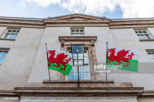welsh flags flying in abergavenny, wales - welsh flag stock pictures, royalty-free photos & images