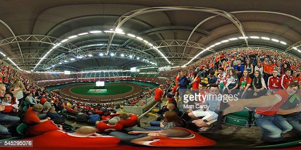 Welsh football fans gather inside the Principality Stadium which is showing the Wales v Portugal game on a giant screen on July 6 2016 in Cardiff...