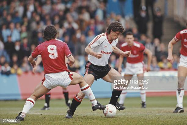 Welsh footballer and forward with Manchester United Mark Hughes pictured making a run with the ball during play in the League Division One match...