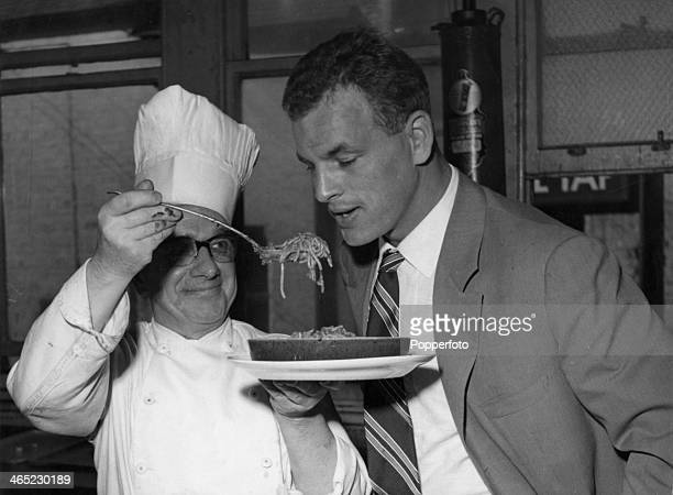 Welsh footballer John Charles is offered a plate of spaghetti at a hotel in Cheshire 2nd October 1957 Charles is in the UK to play for Juventus...