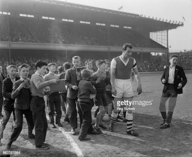 Welsh footballer Mel Charles is pursued by a crowd of young autograph hunters during his first game for Arsenal in the Reserves against Charlton...