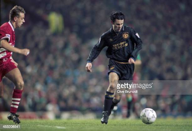 Welsh footballer Ryan Giggs of Manchester United moves away from Rob Jones of Liverpool during an English Premier League match at Anfield Liverpool...