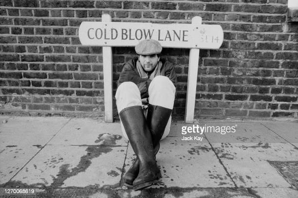 Welsh footballer Steve Lovell of Millwall FC sitting in front of a street sign for Cold Blow Lane in London SE14, 12th February 1985.
