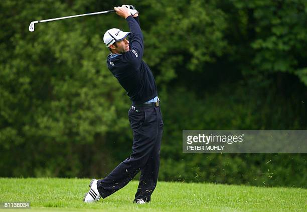 Welsh golfer Bradley Dredge plays his second shot out of the rough on the 2nd fairway during the fourth round of the Irish Open at the Adare Manor in...