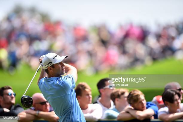 Welsh golfer Bradley Dredge watches his drive from the 3rd tee during the final round of the PGA Championship at Wentworth Golf Club in the town of...
