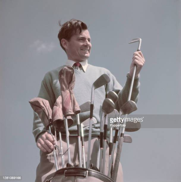 Welsh golfer Dai Rees selects an iron club from his bag during a round of golf on the links course at Royal Troon Golf Club in Troon, Scotland in May...