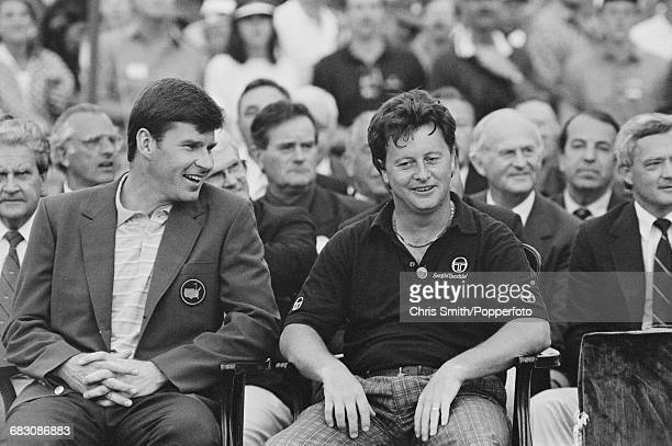 Welsh golfer Ian Woosnam pictured sitting on right with the previous year's winner English golfer Nick Faldo at the green jacket presentation...