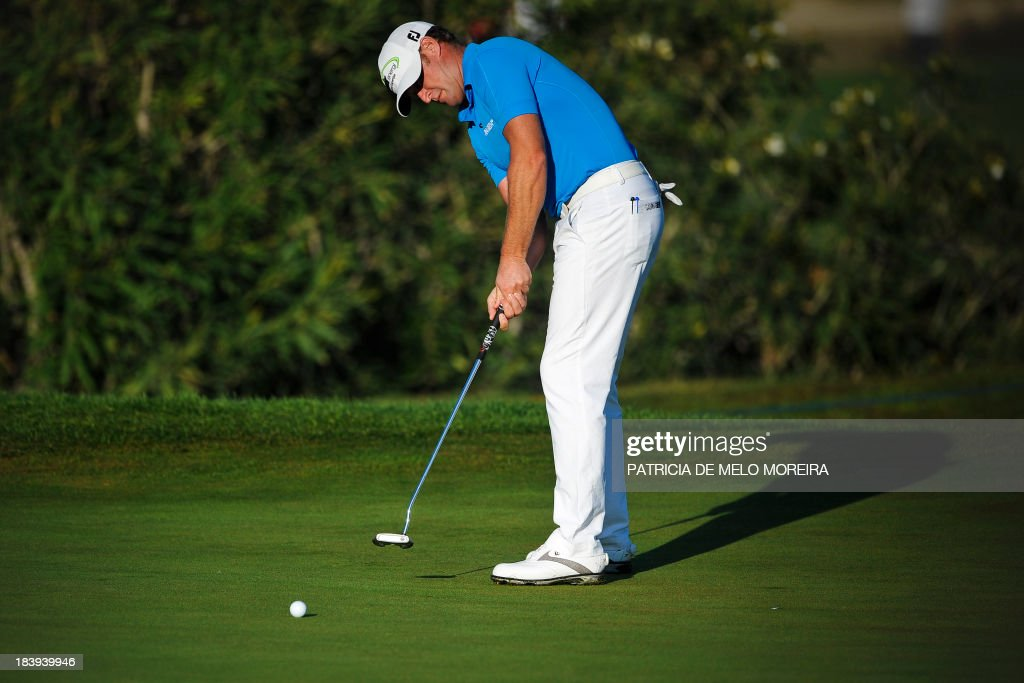 Welsh golfer Jamie Donaldson puts to the 10th hole during the first day of the Portugal Masters golf tournament at Victoria Golf Course in Vilamoura, southern Portugal, on October 10, 2013.