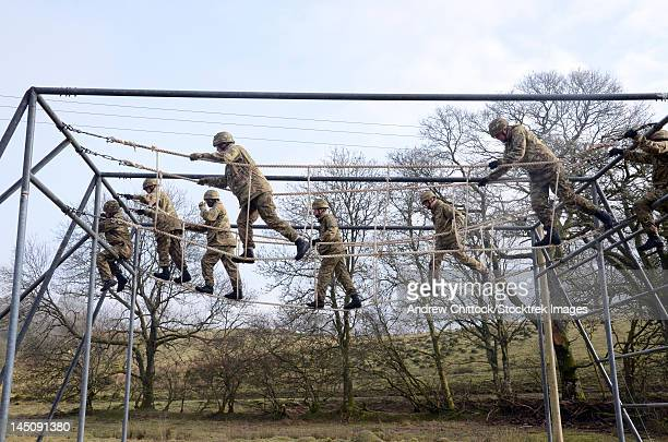 Welsh Guards perform basic training on the assault course at Sennybridge Training Area.
