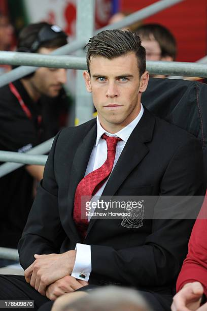 Welsh international Gareth Bale sits on the subs bench during the International Friendly match between Wales v Ireland at the Cardiff City Stadium on...