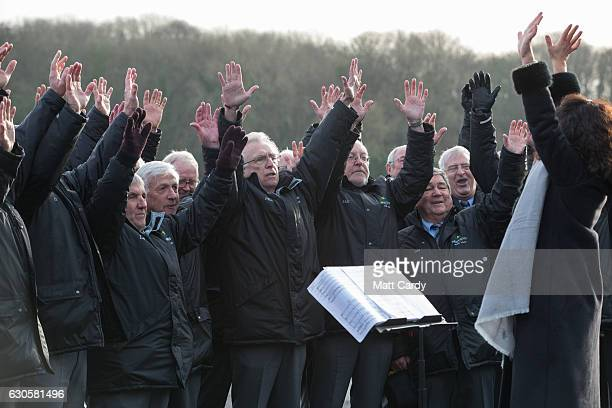 Welsh male choir entertains the crowd ahead of the first race during the 2016 Coral Welsh Grand National at Chepstow Racecourse on December 27 2016...