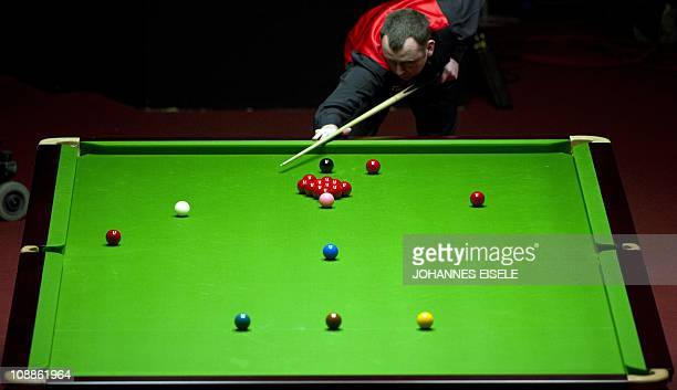 Welsh Mark Williams plays the ball during a German Masters snooker final match against British Mark Selby on February 6 2011 in Berlin's Tempodrom...